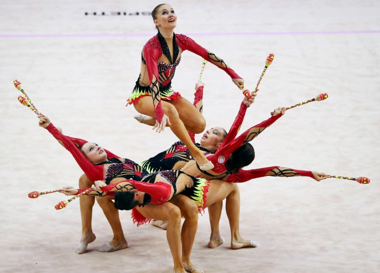 Gymnasts on the Azerbaijan team perform during the group all-arround competition of the GAZPROM World Cup Rhythmic Gymnastics at Porsche Arena in Stuttgart, Germany. (Alex Grimm/Bongarts/Getty Images)