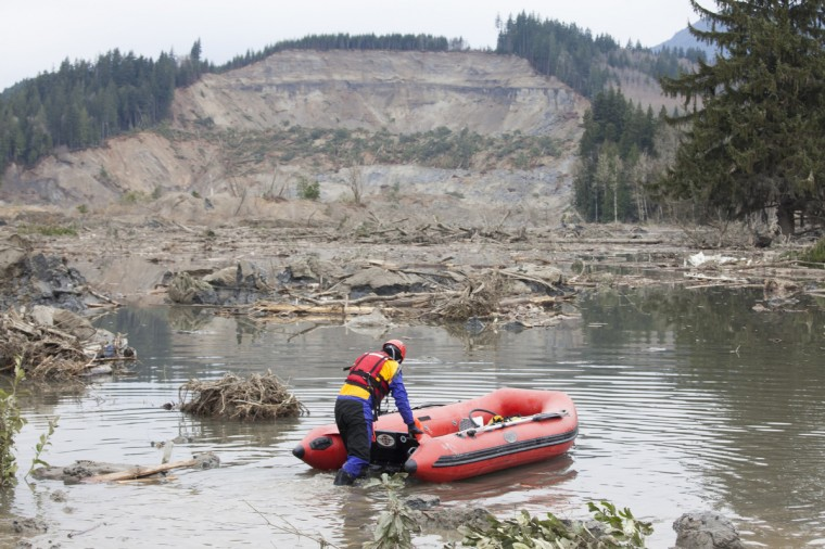 A search and rescue worker looks for survivors in the aftermath of a mudslide in Oso, Washington. A massive mudslide on March 22 has killed at least fourteen and left many missing. (David Ryder/Getty Images)