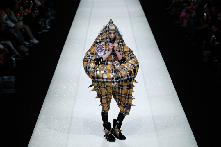 A model showcases designs on the catwalk during the CRZ Collection show of Mercedes-Benz China Fashion Week Autumn/Winter 2014/2015 at the 751D-PARK Central Hall in Beijing, China. (Lintao Zhang/Getty Images)