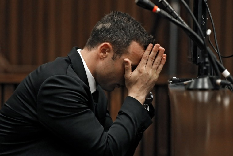 South African Paralympic athlete Oscar Pistorius, accused of murdering his girlfriend Reeva Steenkamp waits prior to a hearing of his trial at the North Gauteng High Court in Pretoria. (Siphiwe Sibeko/Getty Images)