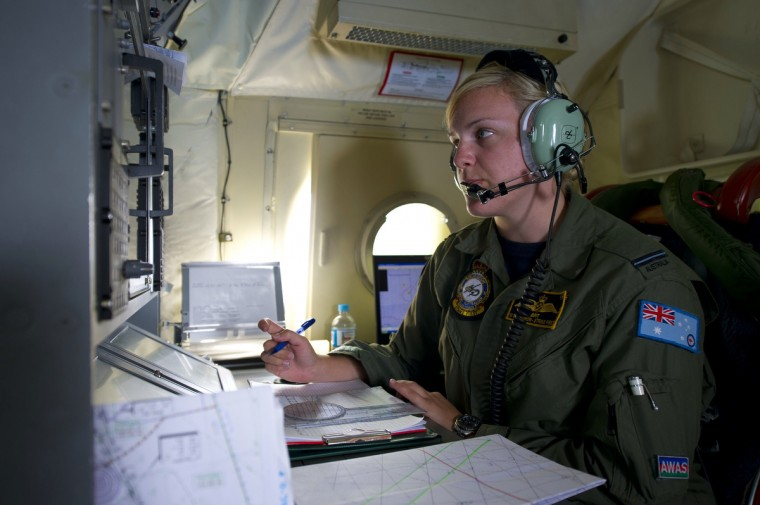 This handout photo taken on March 19, 2014 shows Royal Australian Air Force Navigation and Communications Officer, Flying Officer Brittany Sharpe from 10 Squadron, coordinating all communications between planes from aboard an AP-3C Orion over the southern Indian Ocean. (via AFP/Getty images)