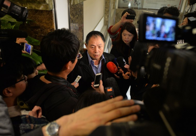 "Wen Wancheng (C), who is the spokesman for the Chinese relatives of passengers from missing Malaysia Airlines flight MH370, gives comments to the media at the Metro Park Lido Hotel in Beijing on. Wen, the father of a Chinese passenger on board Malaysia Airlines 370, clung to hope on March 20 despite Australia's announcement satellites have spotted possible aircraft debris, insisting ""My son is still alive"". Wen's son was one of 153 Chinese passengers on the flight which disappeared on March 8 during a flight to Beijing. (Mark Ralston/Getty Images)"