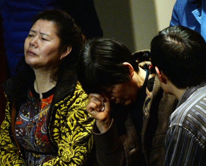 Chinese relatives of passengers from the missing Malaysia Airlines flight MH370 react as they wait for news at the Metro Park Lido Hotel in Beijing on March 20, 2014. An investigation into the pilots of missing Malaysia Airlines flight 370 intensified on March 17 after officials confirmed that the last words spoken from the cockpit came after a key signaling system was manually disabled. (Mark Ralston/Getty Images)