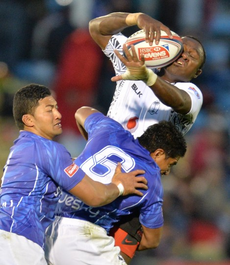 Fiji's Pio Tuwai is tackled by Samoa's Sani Niue (6) and Gtegory Foe during their Tokyo Sevens 2014 match, part of the Rugby Sevens World Series, in Tokyo. (Kazuhiro Nogi/AFP/Getty Images)