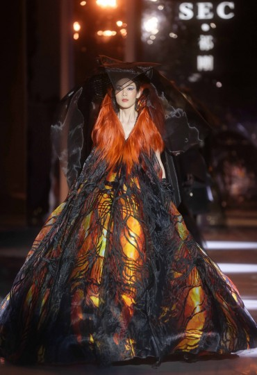 "A model parades creations of ""SEC Qi Gang Collection"" designed by Qi Gang during the bi-annual China Fashion Week in Beijing. The biannual China Fashion Week is being held in Beijing from March 25 to 31. (Getty Images)"