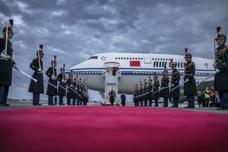 Honor guards prepare to leave after the arrival of China's President Xi Jinping at the Lyon Saint-Exupery Airport. Xi arrived in France for a three-day state visit. (Jeff Pachoud/Getty Images)
