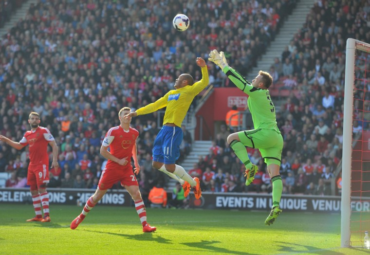 Newcastle United's French striker Yoan Gouffran (L) vies with Southampton's Polish goalkeeper Artur Boruc (R) during the English Premier League football match between Southampton and Newcastle United at St Mary's Stadium in Southampton, southern England on March 29, 2014. (Glyn Kirk / AFP/Getty Images)