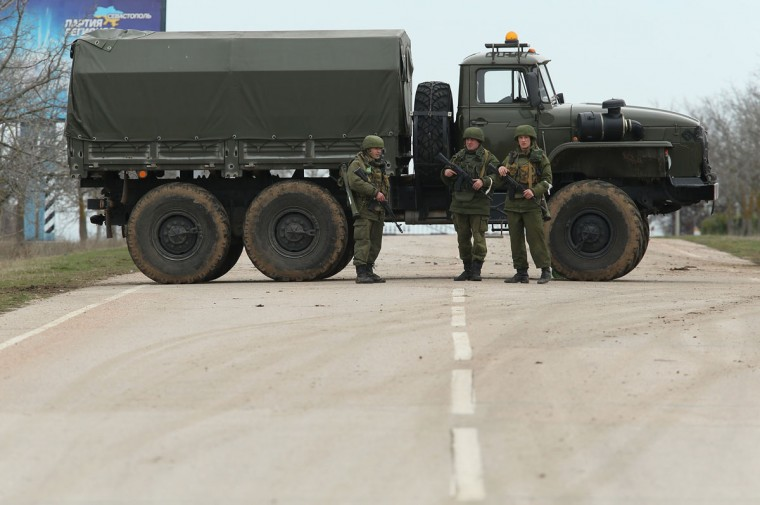 A truck and soldiers block the road leading to Babek Airport near Sevastopol that is occupied by Russian troops in Crimea on March 2, 2014 near Balbek, Ukraine. The new government of Ukraine has appealed to the United Nations Security Council for help against growing Russian intervention in Crimea, where thousands of Russian troops reportedly arrived in recent days at Russian military bases there and also occupy key government and other installations. (Sean Gallup/Getty Images)