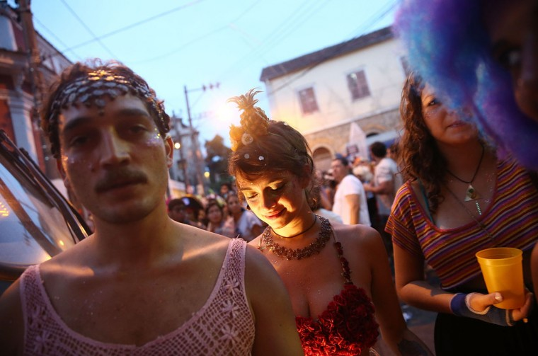 People celebrate during a street carnival bloco in the Santa Teresa neighborhood on March 5, 2014 in Rio de Janeiro, Brazil. (Photo by Mario Tama/Getty Images)