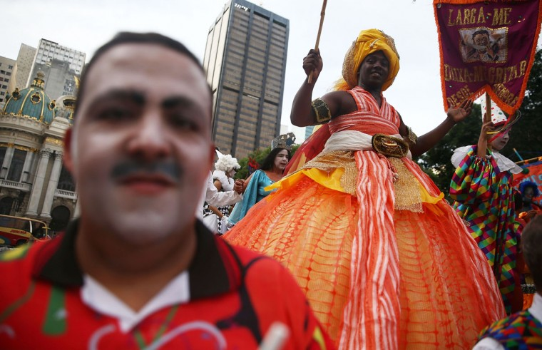 People celebrate at a street carnival bloco in the Lapa neighborhood on March 5, 2014 in Rio de Janeiro, Brazil. (Photo by Mario Tama/Getty Images)