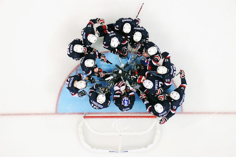 United States athletes huddle before the Ice Sledge Hockey Preliminary Round Group A match between the United States and Italy at Shayba Arena on March 8, 2014 in Sochi, Russia. (Photo by Dennis Grombkowski/Getty Images)