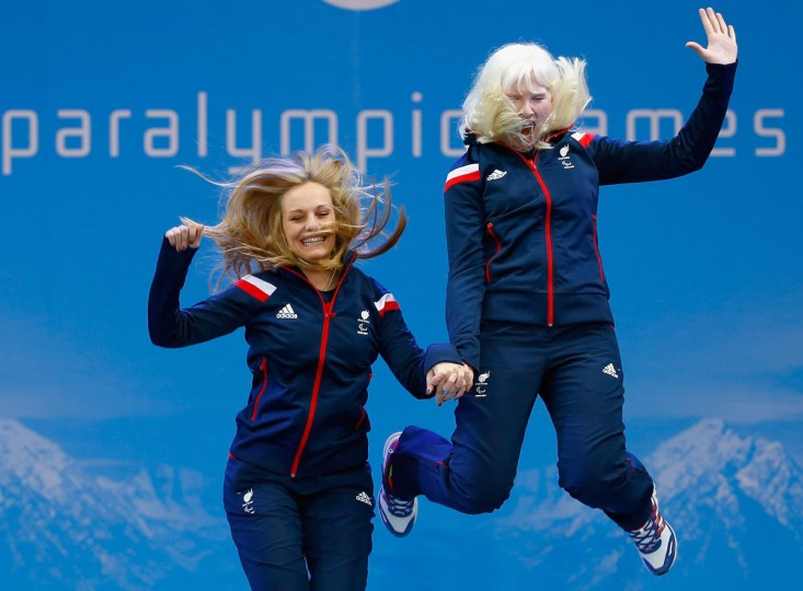 Gold medallists Kelly Gallagher of Great Britain (R) and guide Charlotte Evans celebrate during the medal ceremony for the Women's Super-G - Visually Impaired during day three of Sochi 2014 Paralympic Winter Games at Rosa Khutor Alpine Center on March 10, 2014 in Sochi, Russia. (Photo by Tom Pennington/Getty Images)