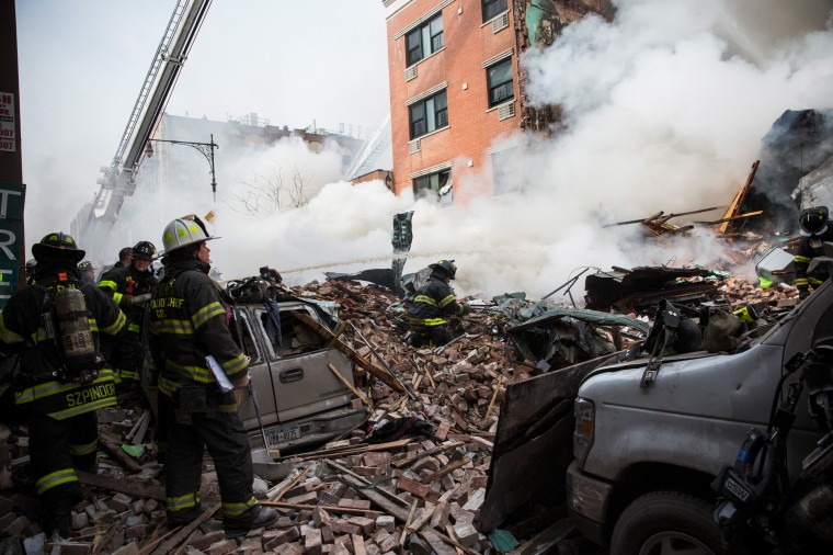 Firefighters from the Fire Department of New York (FDNY) respond to a 5-alarm fire and building collapse at 1646 Park Ave in the Harlem neighborhood of Manhattan March 12, 2014 in New York City. Reports of an explosion were heard before the collapse of two multiple-dwelling buildings that left at least 11 injured. (Photo by Andrew Burton/Getty Images)