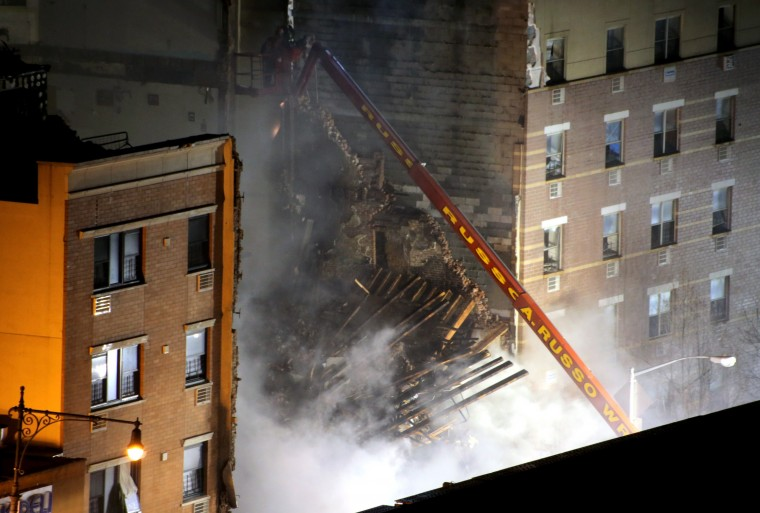 New York City firefighters respond to a five-alarm fire and building collapse at 1646 Park Ave in the Harlem neighborhood of Manhattan March 12, 2014 in New York City. Reports of an explosion were heard before the collapse of two multiple-dwelling buildings that left at least 11 injured. Emergency personnel continue the search for around 10 people who remain missing, according to published reports. (Photo by Justin Heiman/Getty Images)