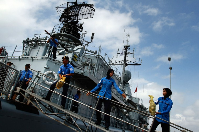 The crew of the Malaysian Navy ship KD Kasturi prepare the ship during refueling and restocking at Kuantan Naval Baseon March 15, 2014 in Kuantan, Malaysia. During a press conference today the Malaysian Prime Minister, Najib Razak said that investigators had discovered evidence from satellite and radar systems indicating that the communication systems of the aircraft had been intentionally disabled. The search for the plane in the South China Sea has now been abandoned with the focus switching to two flight corridors, the first stretching from the border of Kazakhstan and Turkmenistan to northern Thailand and a second stretching from Indonesia to the South Indian Ocean.The missing aircraft was carrying 227 passengers and 12 crew. (Photo by Rahman Roslan/Getty Images)