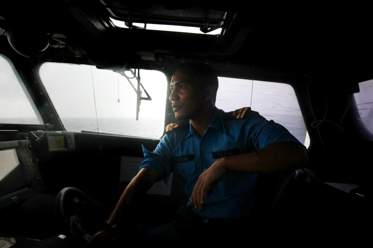 A member of the Malaysian Navy pilots a boat in the South China Sea on March 15, 2014 in Kuantan, Malaysia. During a press conference today the Malaysian Prime Minister, Najib Razak said that investigators had discovered evidence from satellite and radar systems indicating that the communication systems of the aircraft had been intentionally disabled. The search for the plane in the South China Sea has now been abandoned with the focus switching to two flight corridors, the first stretching from the border of Kazakhstan and Turkmenistan to northern Thailand and a second stretching from Indonesia to the South Indian Ocean.The missing aircraft was carrying 227 passengers and 12 crew. (Photo by Rahman Roslan/Getty Images)
