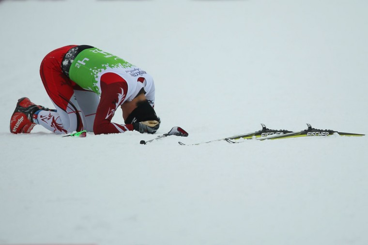Yoshihiro Nitta of Japan reacts after finishing his leg in the 4 x 2.5km Mixed Relay cross-country on day eight of the Sochi 2014 Paralympic Winter Games at Laura Cross-country Ski & Biathlon Center on March 15, 2014 in Sochi, Russia. (Photo by Mark Kolbe/Getty Images)