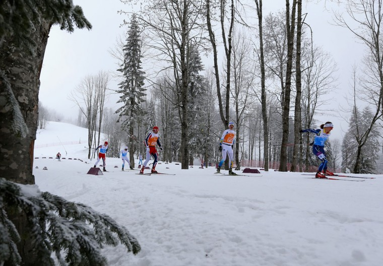 Competitors ski in the Mixed 4 x 2.5km Relay Cross-Country Skiing event during day eight of Sochi 2014 Paralympic Winter Games at Laura Cross-country Ski & Biathlon Center on March 15, 2014 in Sochi, Russia. (Photo by Ronald Martinez/Getty Images)