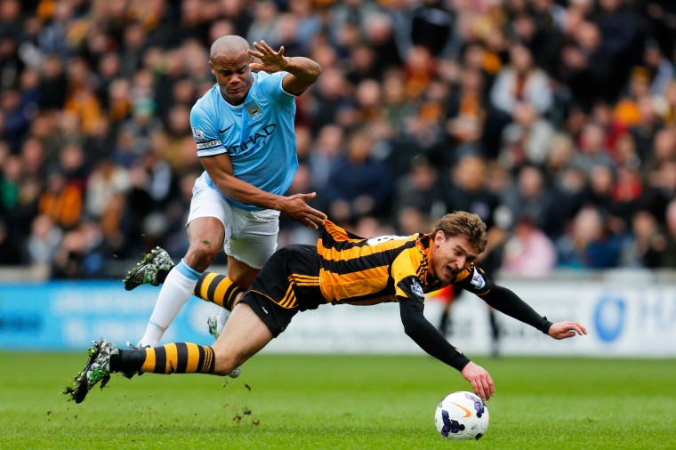 Nikica Jelavic of Hull City is brought down by Vincent Kompany of Manchester City during the Barclays Premier league match between Hull City and Manchester City at KC Stadium on March 15, 2014 in Hull, England. Kompany was shown the red card for this chalenge. (Photo by Paul Thomas/Getty Images)
