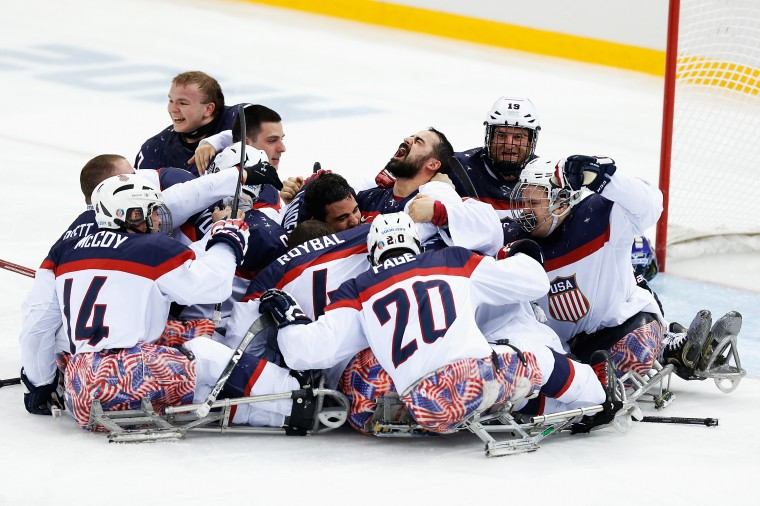 The USA team celebrate winning the Ice Sledge Hockey Gold Medal match between Russia and USA at the Shayba Arena during day eight of the 2014 Paralympic Winter Games on March 15, 2014 in Sochi, Russia. (Photo by Harry Engels/Getty Images)