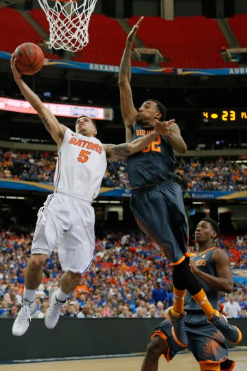 Scottie Wilbekin #5 of the Florida Gators goes up for a shot against Jordan McRae #52 of the Tennessee Volunteers during the semifinals of the SEC Men's Basketball Tournament at Georgia Dome on March 15, 2014 in Atlanta, Georgia. (Photo by Kevin C. Cox/Getty Images)