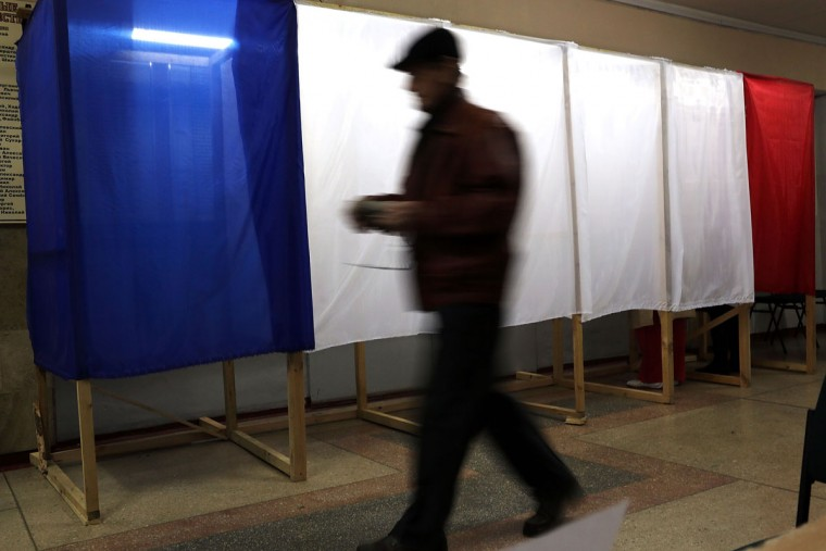 A man votes inside a polling station on March 16, 2014 in Simferopol, Ukraine. Crimeans went to the polls Sunday in a vote that will decide whether the peninsular region should secede from Ukraine. (Spencer Platt/Getty Images)