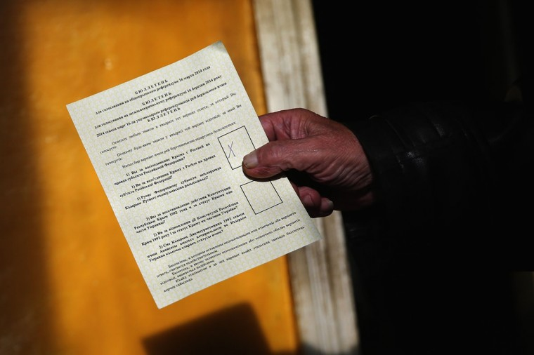 A referendum ballot with a Russia vote is displayed as referendum staff collect the votes of people too infirm to visit a polling stations on March 16, 2014 in a predominantly Russian area of Bachchisaray, Ukraine. (Dan Kitwood/Getty Images)