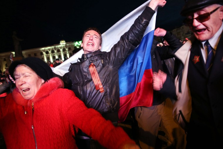 People in Lenin Square attend a pro-Russian rally after a day of voting on March 16, 2014 in Simferopol, Ukraine. Crimeans went to the polls Sunday in a vote that will decide whether the region will break away from mainland Ukraine. (Spencer Platt/Getty Images)