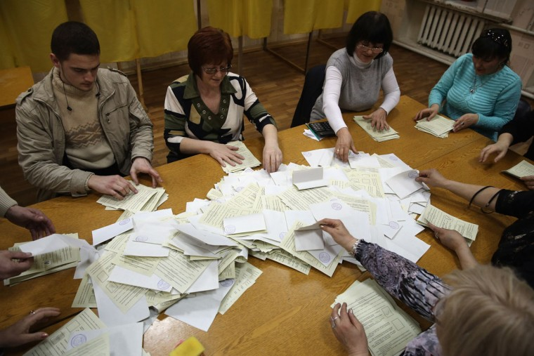 Election staff begin the count at a polling station after a day of voting on March 16, 2014 in Bachchisaray, Ukraine. Crimeans went to the polls Sunda in a vote that will decide whether the peninsular region will break away from mainland Ukraine. (Dan Kitwood/Getty Images)