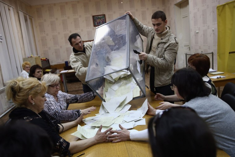 Election staff begin the count at a polling station after a day of voting on March 16, 2014 in Bachchisaray, Ukraine. (Dan Kitwood/Getty Images)