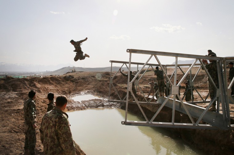 A soldier with the Afghan National Army's (ANA) National Engineer Brigade tries to make dry land after leaping from the top of a Mabey-Johnson portable pre-fabricated bridge which his unit was learning to construct with the help of U.S. Navy Seabees from Naval Mobile Construction Battalion (MCB) 28 at the ANA's combined Fielding Center on March 18, 2014 in Kabul, Afghanistan. The Seabees are attached to the U.S. Army's 130th Engineer Brigade are responsible for training ANA soldiers various engineering tasks at the facility. In a recent speech to his country's parliament, Afghan President Hamid Karzai said U.S. troops can leave Afghanistan at the end of the year because his military was ready to take over responsibility for the nation's security. (Scott Olson/Getty Images)