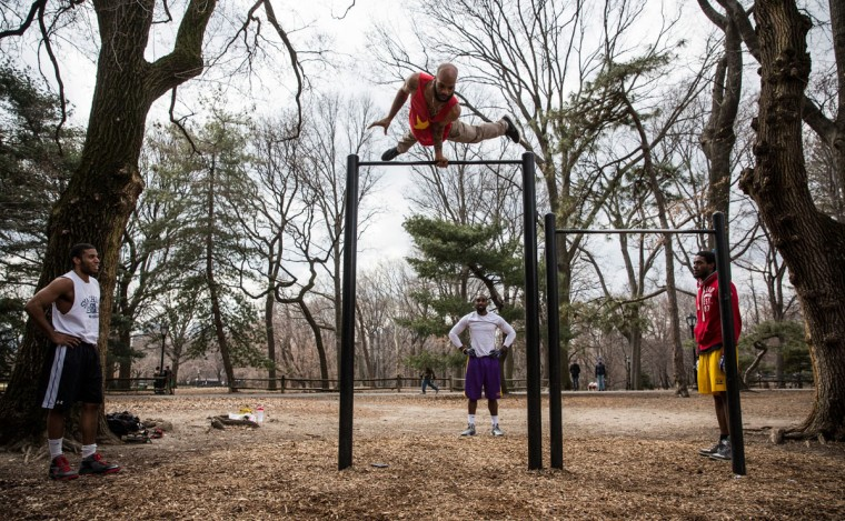 "Members of ""Team S3lfish"" - an extreme calisthenics team - practice on pull-up bars in Central Park on March 20, 2014 in New York, United States. Today marks the first official day of Spring - the spring equinox occurred at 12:57PM today. (Photo by Andrew Burton/Getty Images)"