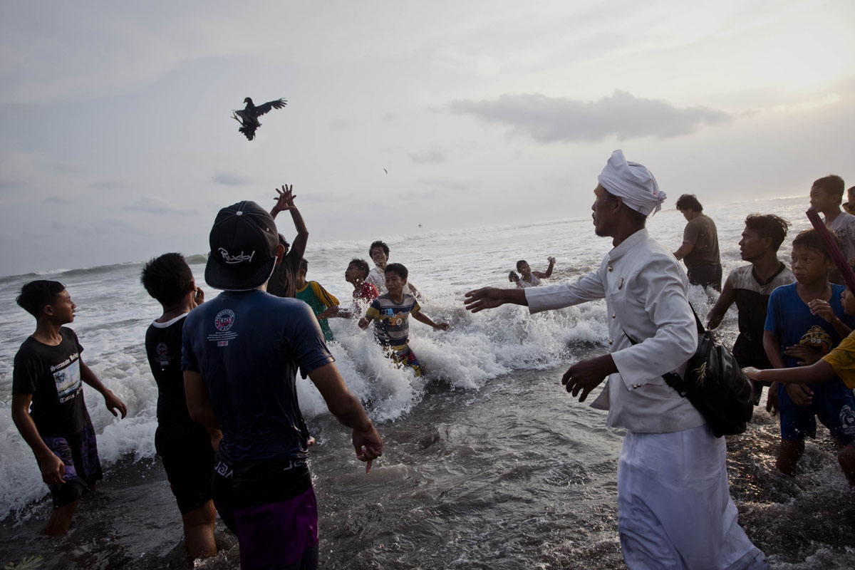 When a chicken meets the sea: A day of cleansing in Indonesia