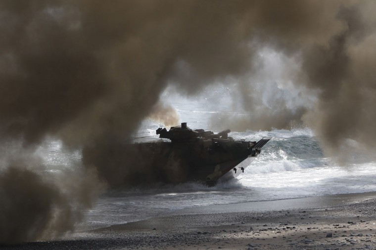 South Korean Marines' Landing Vehicle Tracked (LVT) move position during a joint landing operation with U.S. Marines at Pohang seashore. (Photo by Chung Sung-Jun/Getty Images)