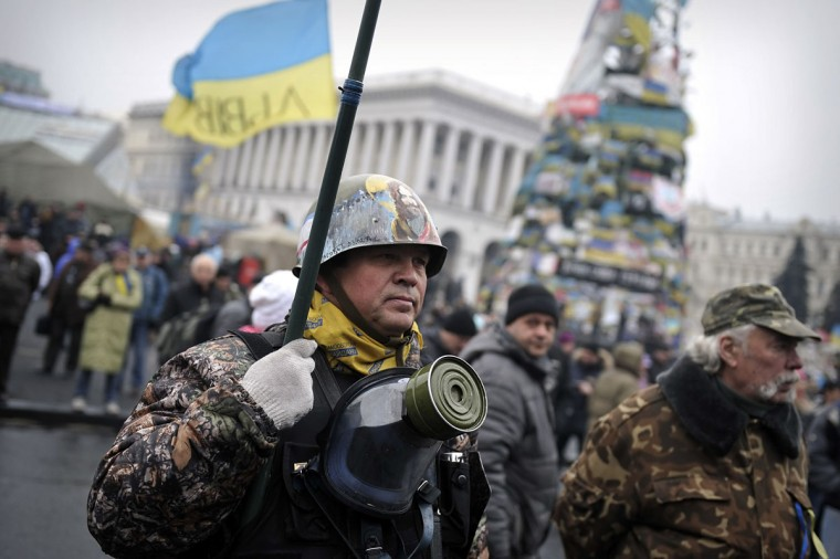 "A Maidan self-defense unit member stands at the Independence Square in central Kiev on March 2, 2014. Ukraine accused Russia of sending thousands of extra troops into Crimea as the Kremlin vowed to help restore calm on the flashpoint peninsula, and Washington warned of ""costs"" to Moscow should it use force. (Louisa Gouliamaki/AFP/Getty Images)"