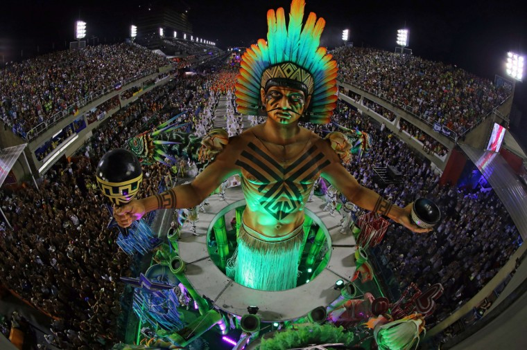 Revelers of the Mangueira samba school perform during the first night of carnival parade at the Sambadrome in Rio de Janeiro, Brazil on March 3, 2014. (Tasso Marcelo Leal/AFP/Getty Images)