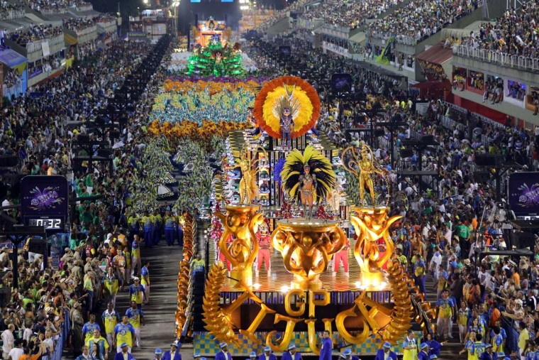 Revelers of the Unidos da Tijuca samba school perform during the second night of carnival parade at the Sambadrome in Rio de Janeiro, Brazil on March 4, 2014. (Lealtasso Marcelo/AFP/Getty Images)