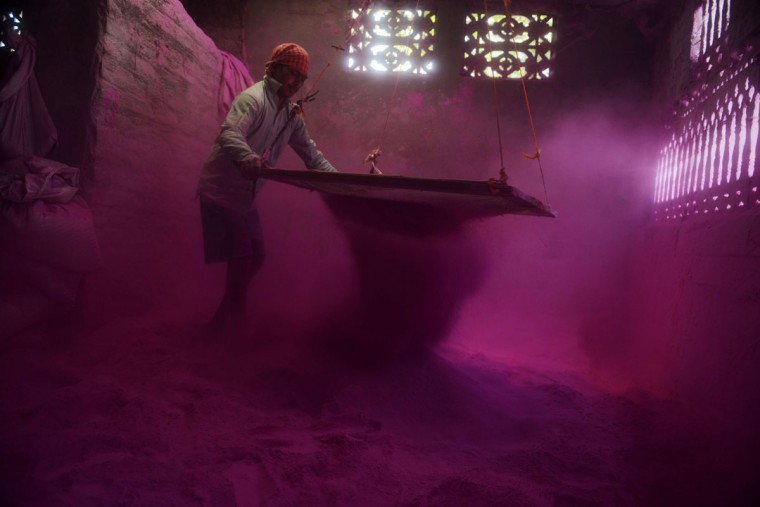 An Indian worker sifts colored powder, known as 'gulal', to be used during the forthcoming spring festival of Holi, inside a factory at Fulbari village on the outskirts of Siliguri on March 9, 2014. Holi, the popular Hindu spring festival of colors, will be celebrated on March 16 this year. (Diptendu Dutta/AFP/Getty Images)