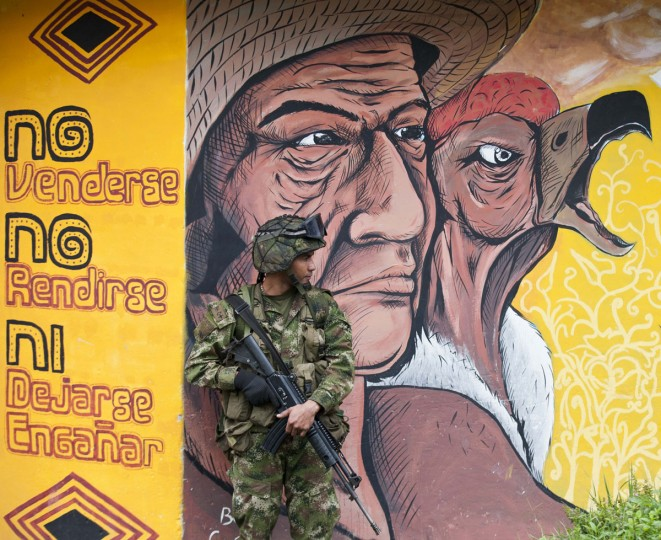 A soldier stands guard outside a polling station in Toribio, deparment of Cauca, during parliamentary elections in Colombia, on March 9, 2014. Colombians went to the polls on Sunday to elect new legislators, in a vote seen as a referendum on peace talks with leftist guerrillas and a bellwether for May's presidential election. (LUIS ROBAYO/AFP/Getty Images)