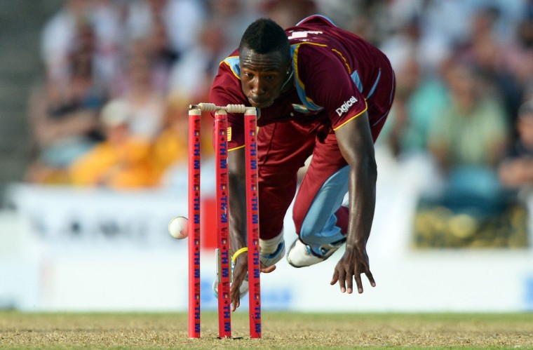 West Indies cricketer Andre Russell runs out England's James Tredwell during the first T20 match between England and West Indies at the Kensington Oval in Bridgetown on March 9, 2014. West Indies won the match by 27 runs. (JEWEL SAMAD/AFP/Getty Images)