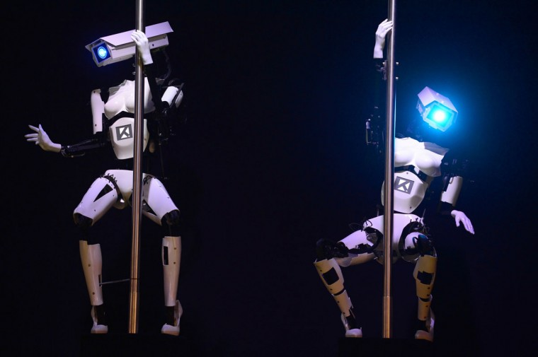 Robots perform a pole dance at the booth of the Tobit Software company on the eve of the start of the 2014 CeBIT technology trade fair on March 9, 2014 in Hanover, central Germany. (JOHN MACDOUGALL/AFP/Getty Images)
