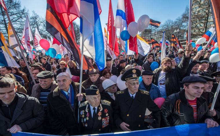 Pro-Kremlin activists rally in support of ethnic Russians in Ukraine in central Moscow, on March 10, 2014. (DMITRY SEREBRYAKOV/AFP/Getty Images)