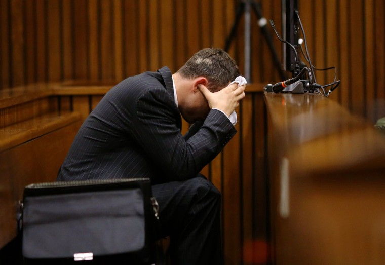 Olympic and Paralympic track star Oscar Pistorius is pictured during a hearing on the sixth day of his trial for the 2013 murder of his girlfriend, on March 10, 2014 at the high court in Pretoria. (SIPHIWE SIBEKO/AFP/Getty Images)