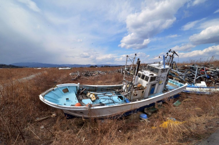Fishing boats sit grounded on land three years after the disaster in Namie, near the striken TEPCO Fukushima Dai-ichi nuclear plant in Fukushima prefecture on March 10, 2014, one day before the third anniversary of March 11 massive earthquake and tsunami. (YOSHIKAZU TSUNO/AFP/Getty Images)
