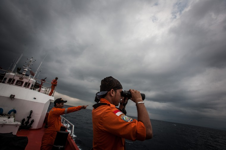 "Indonesian national search and rescue agency personel watch over high seas during a search operation for missing Malaysia Airlines flight MH370 in the Andaman Sea on March 15, 2014. Investigators now believe a Malaysian jet that vanished was commandeered by a ""skilled, competent"" flyer who piloted the plane for hours, a senior Malaysian military official said on March 15 as Prime Minister Najib Razak prepared to address the nation. (Chaideer Mahyuddin/AFP/Getty Images)"