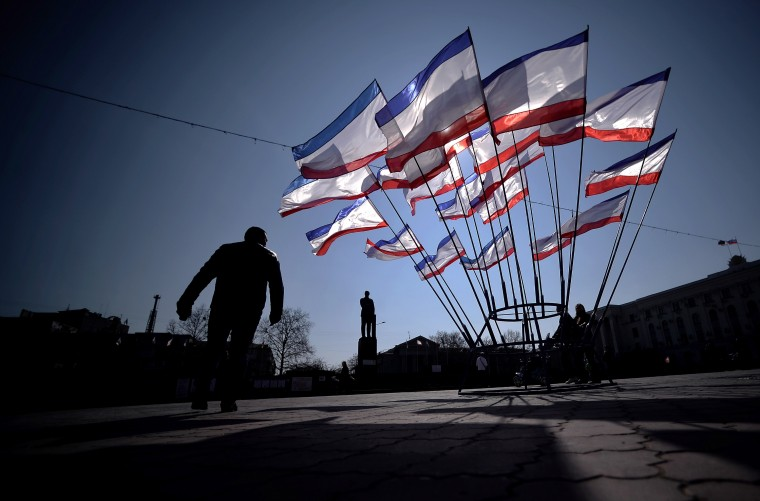 A man walks past Crimean flags in Simferopol's Lenin Square, on March 15, 2014. Ukraine braced for a breakaway vote in Crimea as deadly violence flared again in the ex-Soviet country's tinderbox east amid the biggest East-West showdown since the Cold War. (Filippo Monteforte/AFP/Getty Images)