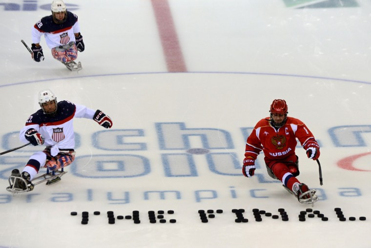 United States' Rico Roman (L) and Russia's Dmitrii Lysov (R) warm up before Sledge Hockey Final match between Russia and USA at XI Paralympic Olympic games in the Shayba stadium close to city of Sochi on March 15, 2014. (Krill Kudryavtsev/AFP/Getty Images)