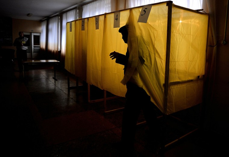 A man exits a voting booth prior to casting his vote in a local school on March 16, 2014, in Simferopol, Ukraine. People in Crimea took to the polls on March 16 for a referendum on breaking away from Ukraine to join Russia, a move that has precipitated a Cold War-style security crisis on Europe's eastern frontier. (Filippo Monteforte/AFP/Getty Images)
