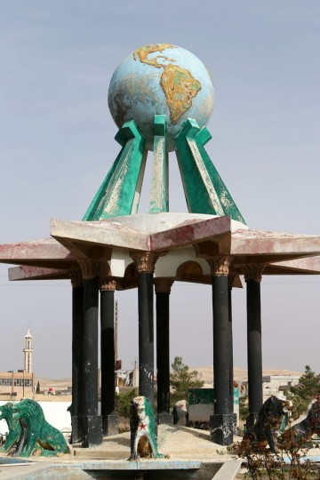 "The ""globe"" sits on a monument decorating the Syrian town of Yabrud on March 16, 2014 after Syria's army and Lebanon's Hezbollah seized full control of the rebel bastion in the strategic Qalamun region near the Lebanese border. The town was once home to some 30,000 people, including a Christian minority, and had been a rebel bastion since early in the Syrian uprising that began in March 2011. (Joseph Eid/AFP/Getty Images)"