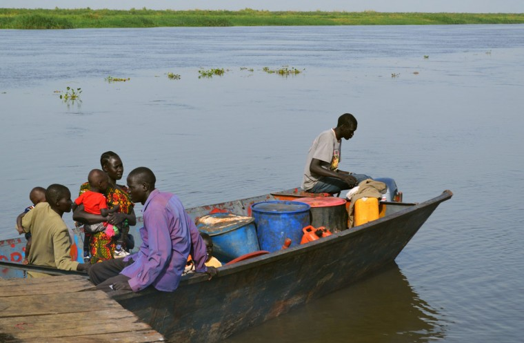 South Sudanese people are seen aboard a boat on March 15, 2014 in Bor, as life come back to normal again following clashes in the recent past. South Sudan's government has been at war with rebel groups since December 15, when a clash between troops loyal to Kiir and those loyal to sacked vice president Riek Machar snowballed into full-scale fighting. Over 930,000 civilians have fled their homes since fighting began, including over quarter of million leaving for neighboring nations as refugees, according to the United Nations. (Samir Bol/AFP/Getty Images)